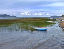 Boat on the lakeside of lago titicaca Stock Photos