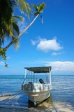 Boat landed on the shore of a tropical beach Stock Photography
