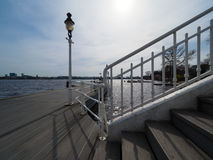 Boat landing-stage with old white lantern Royalty Free Stock Image