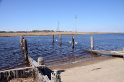 Boat Launch. A boat launch at a remote river on a sunny cloudless day stock image