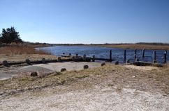 Boat Launch. A boat launch at a remote river on a sunny cloudless day royalty free stock image