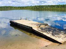 Boat launch dock covered with tires for bumpers Royalty Free Stock Photography