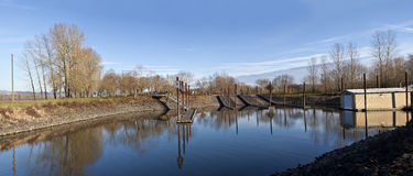 Boat launch pads and steel poles panoramic view OR. Stock Images