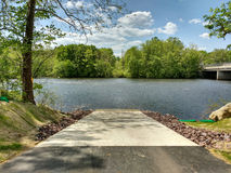 Boat Launch in Walnutport, Pennsylvania, USA. This smooth, inclined slab is a perfect point of entry for water vessels. This boat ramp is in Walnutport Stock Images