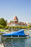 A boat and Lausanne castle of Ouchy (Le Chateau d'Ouchy) near Ge Stock Image