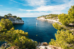 Boat leaves from bay to open sea in Calanques on the azure coast. Beautiful nature of Calanques on the azure coast of France. Calanques - a deep bay surrounded Stock Photography