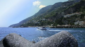 Boat Leaving Amalfi Harbor in Slow Motion stock video