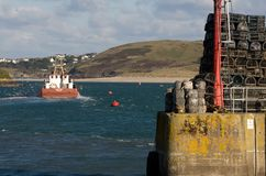 Boat leaving Padstow harbour Cornwall. A boat leaves Padstow harbour and heads seaward up the River Camel estuary in Cornwall Stock Photos