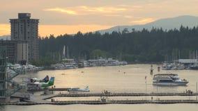 Boat leaving vancouver harbor stock video