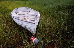 Boat left in the weeds Royalty Free Stock Photo