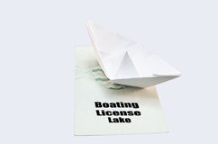 Boat license Lake. Document from the German boat driving license lake. With small paper ship as a symbol Stock Photo