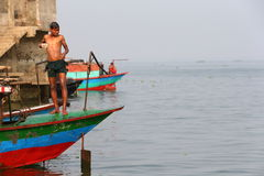 Boat life. Young man washing himself on a boat in Bangladesh Royalty Free Stock Photo