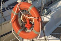 Boat lifebelt in orange plastic in ligurian sea. Sanremo Royalty Free Stock Photos