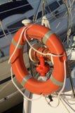 Boat lifebelt in seaport. In orange plastic, Sanremo Italy Stock Image
