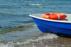 Boat and lifebuoy ring Royalty Free Stock Photography