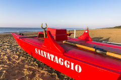 Boat Lifeguard. Lifeguard boat on the beach, in the background the sea Royalty Free Stock Photo