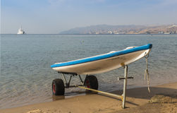 Boat of lifeguard in sandy beach of Eilat Royalty Free Stock Image