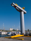 Boat lifter crane. In a marina ready for work Stock Images