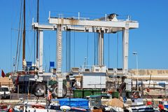 Boat lifting crane, Carboneras. Boat lifting crane in the harbour, Carboneras, Almeria Province, Costa Almeria, Andalusia, Spain, Western Europe Stock Photos