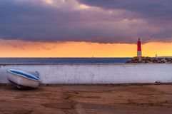 The boat and the lighthouse royalty free stock photo