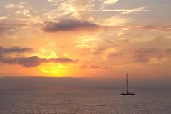 Boat in the Ligurian sea at sunrise Royalty Free Stock Image