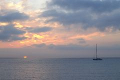Boat in the Ligurian sea at sunrise Royalty Free Stock Photos