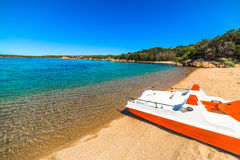 Boat in Liscia di Vacca beach Royalty Free Stock Photos