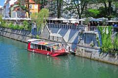 Boat on Ljubljanica river in old city center, Ljubljana, Sloveni. Ljubljana, Slovenia - September 1, 2015 - Boat on Ljubljanica river in old city center on a Stock Photography