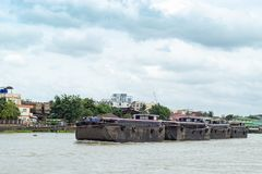 A boat load of sand in the Chao Phraya River , Thailand stock image