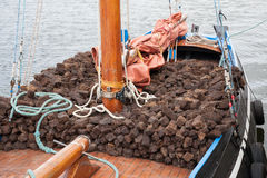 Boat loaded with turf Stock Photos