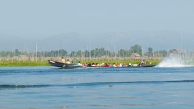 Boat with local people on Inle lake. Burma Royalty Free Stock Photography