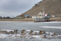 Boat locked in ice in a frozen lake Khuvsgul in northern Mongoli royalty free stock photo