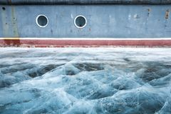 Boat locked in ice in a frozen lake Khuvsgul in northern Mongoli stock images