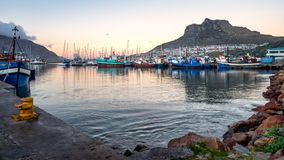 Boat Lot on Body of Water Near Mountain royalty free stock photos