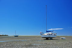 Boat on low tide Royalty Free Stock Images