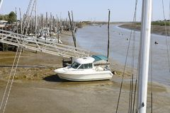 Boat at low tide. stock photography