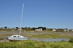 Boat at low tide at Carnac in France Royalty Free Stock Photos
