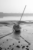 Boat at low tide early morning Walney Channel stock photo