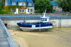 Boat at low tide Stock Photos