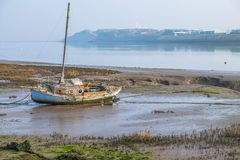 Boat at low tide Stock Image