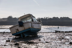 Boat at low tide Royalty Free Stock Photography
