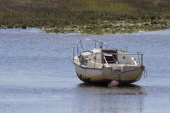 Boat at low tide Royalty Free Stock Images