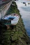 Boat and low tide Royalty Free Stock Image