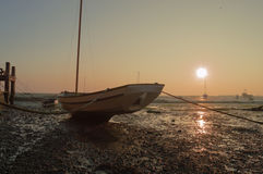 Boat at Low Tide at Sunset  Royalty Free Stock Image