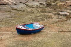 Boat at low tide. A boat without water at low tide royalty free stock images