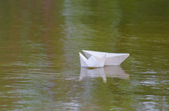 Boat made of paper. Floating in the water Royalty Free Stock Photos