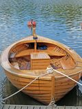 A boat made from wood with a bar. In a bay Stock Image