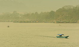 Boat in Maekhong River border of Laos and Thailand. Some parking next to riverside Stock Photos