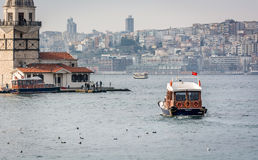 Boat and Maiden's Tower in Istanbul, Turkey Stock Photos
