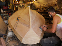 Boat maker. A man making a boat in his workshop, Richmond, London, UK Stock Photo